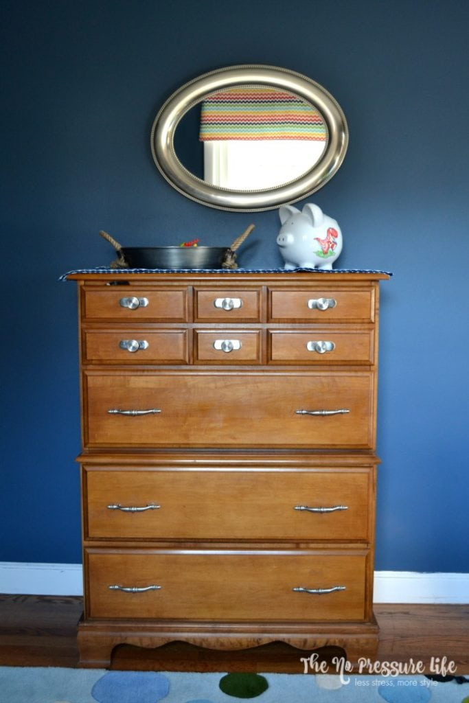 wood dresser against a Benjamin Moore Van Deusen Blue wall