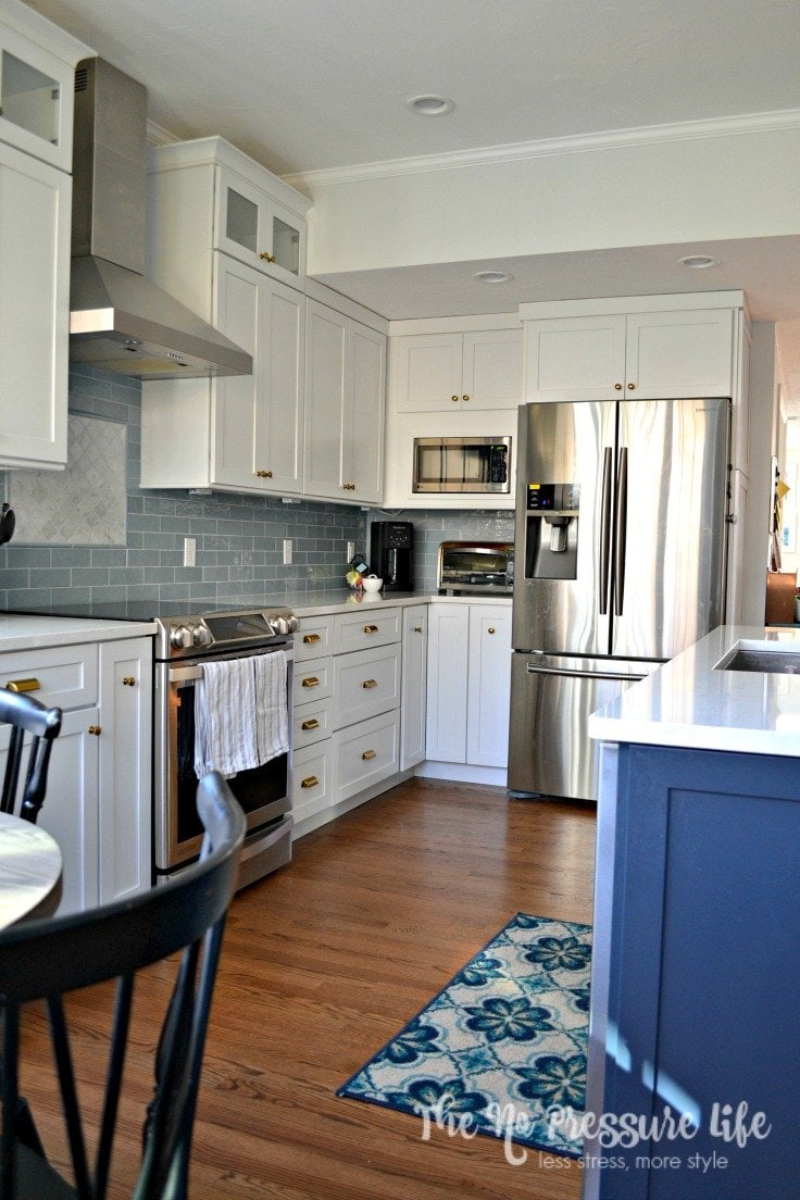 "LOVE this blue and white kitchen! You should see the ""before"". Get kitchen renovation tips for beginners at The No Pressure Life."