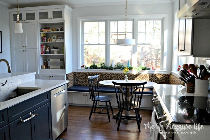 Love this breakfast nook with huge windows! Get kitchen renovation tips to create your dream kitchen at The No Pressure Life.