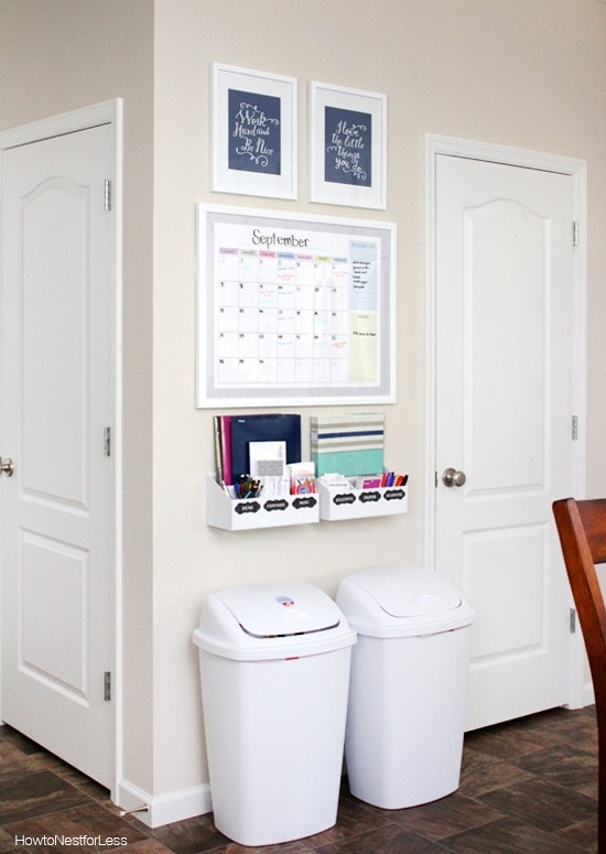 Command center with wall-mounted storage and recycling bins. Via How to Nest for Less.