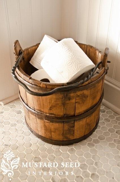 Vintage bucket for toilet paper via Miss Mustard Seed.