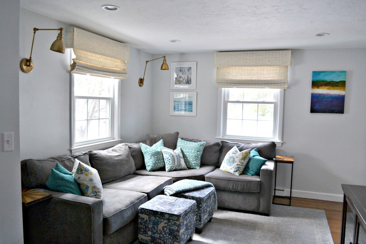 Decorating behind a corner sectional sofa - gray sectional with teal and blue decor