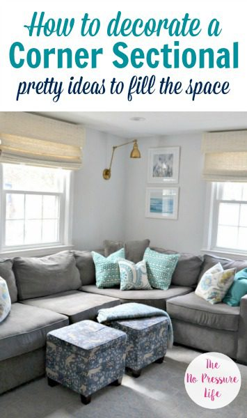 How to decorate above a corner sectional - gray sectional sofa with blue and teal decor