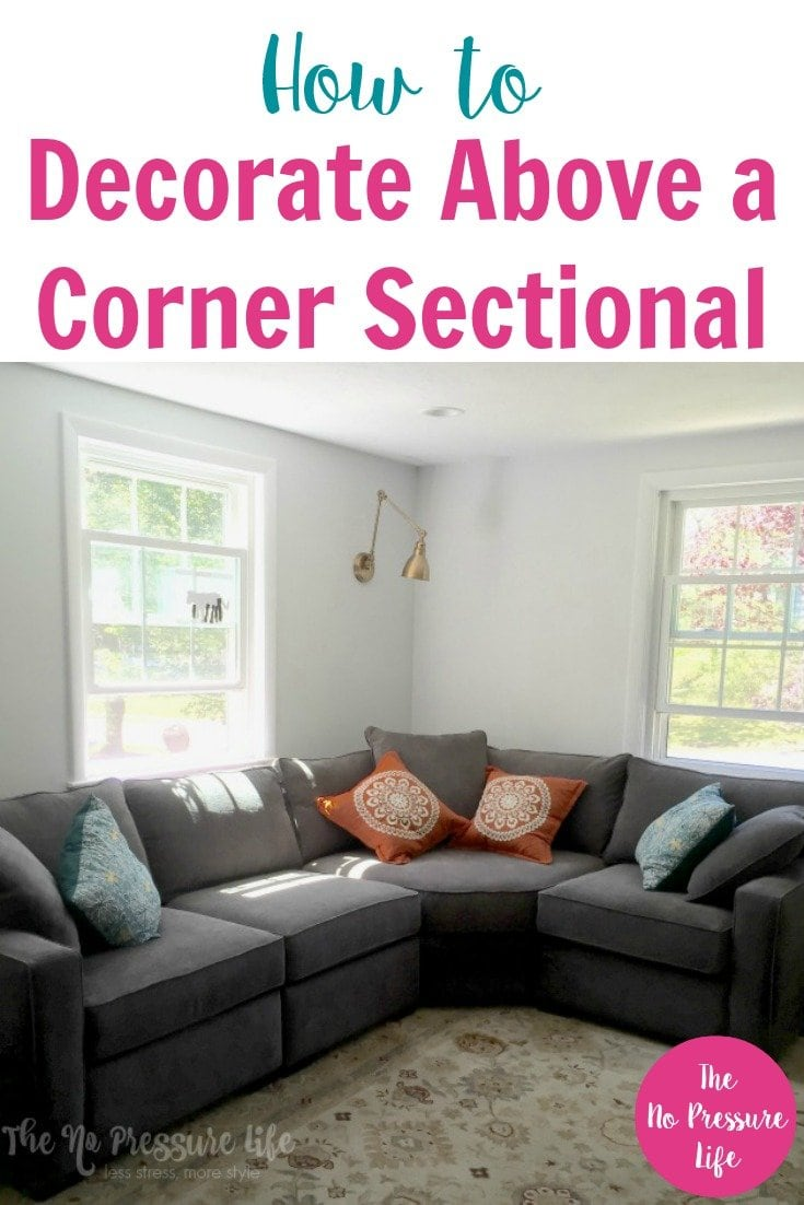 "Gray corner sectional sofa with text ""How to Decorate Above a Corner Sectional"""