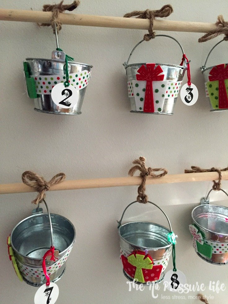 DIY advent calendar for Christmas with mini buckets and wood dowels