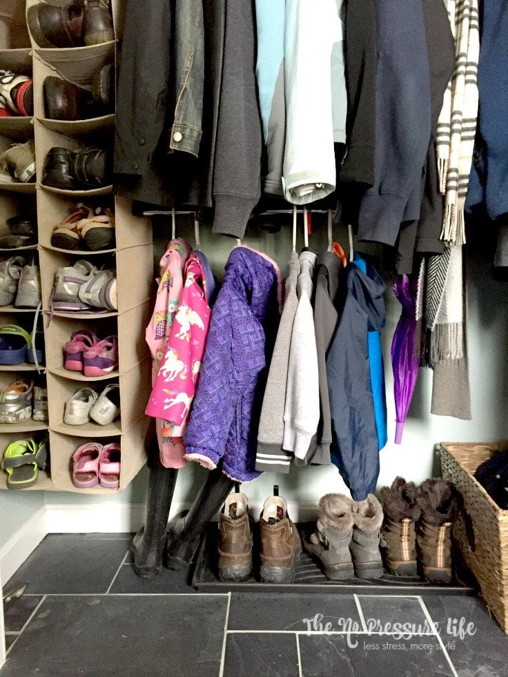 Organized coat closet with two rods and boot tray