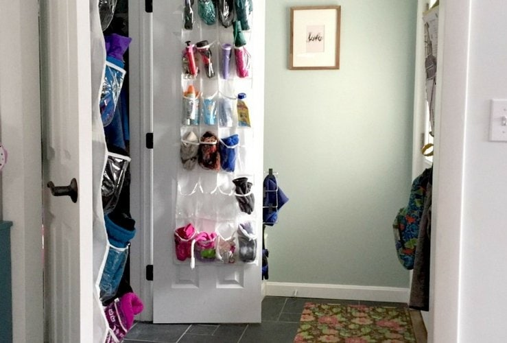 Organize hats and mittens with an over the door shoe organizer.