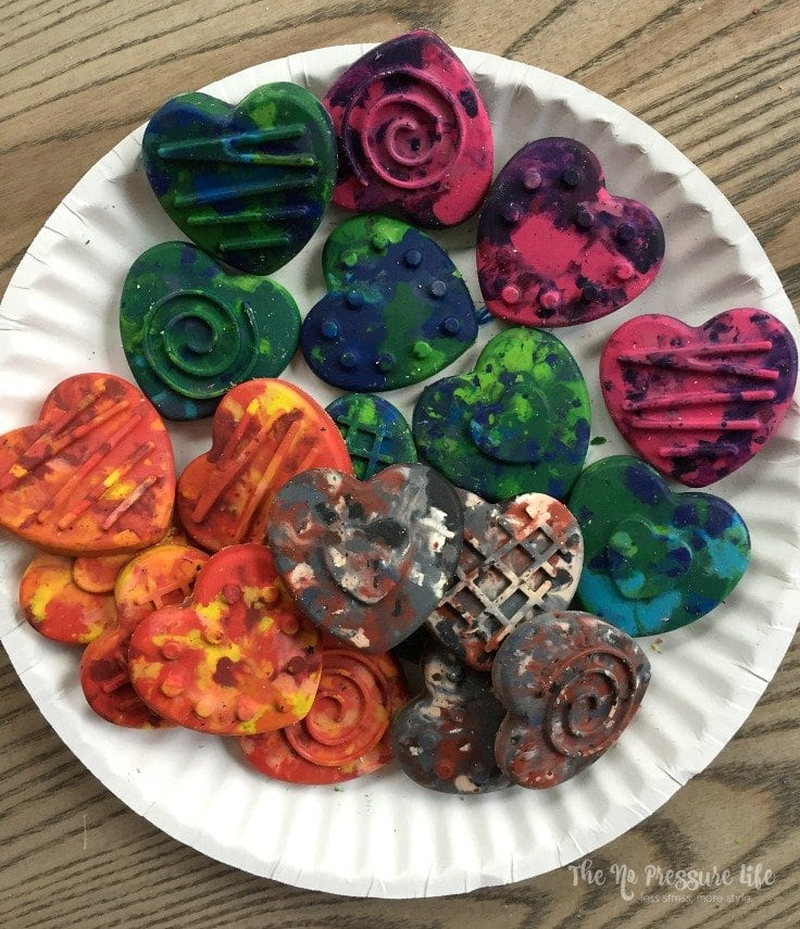 DIY crayons are a fun way to recycle broken crayons and transform them into cute party favors or Valentine's Day treats! Learn how to make them at The No Pressure Life.