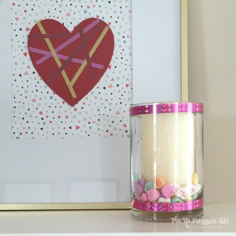 Easy DIY Valentine's Day mantel decorations - art and candle holder on a white mantel