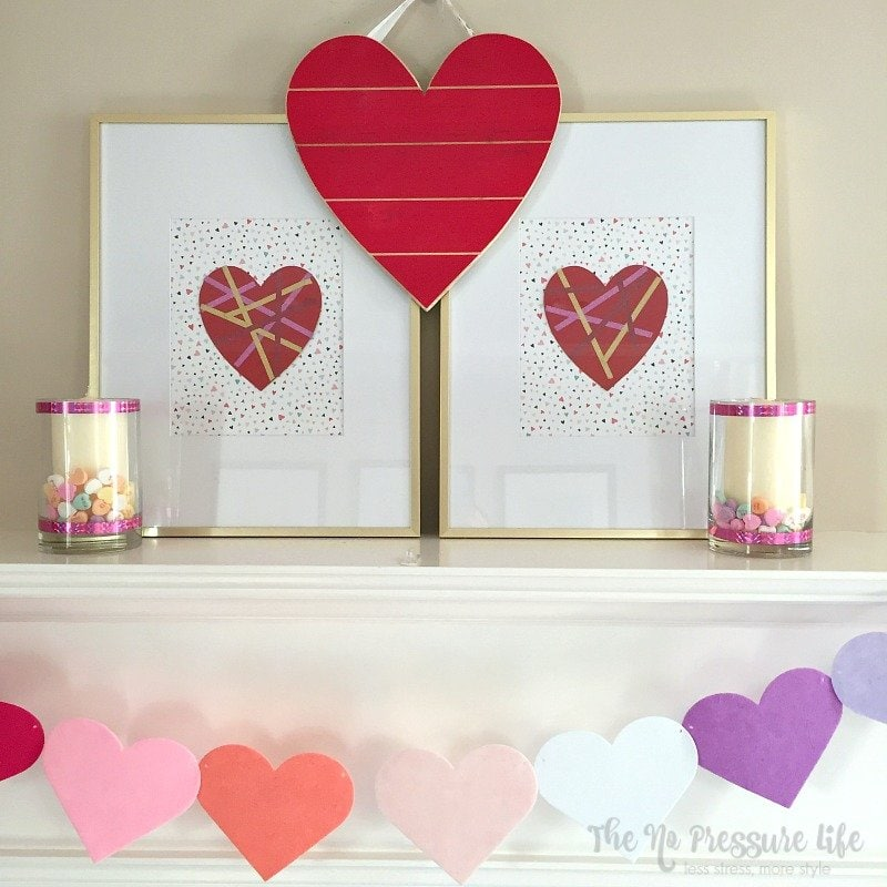 DIY Valentine's Day Mantel Decorations with banner, candle holders and framed hearts.