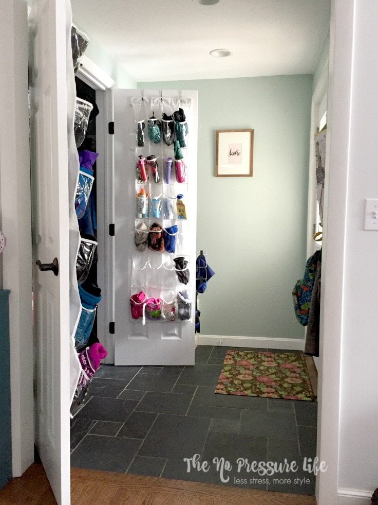 Mudroom with an organized coat closet using shoe pocket organizers
