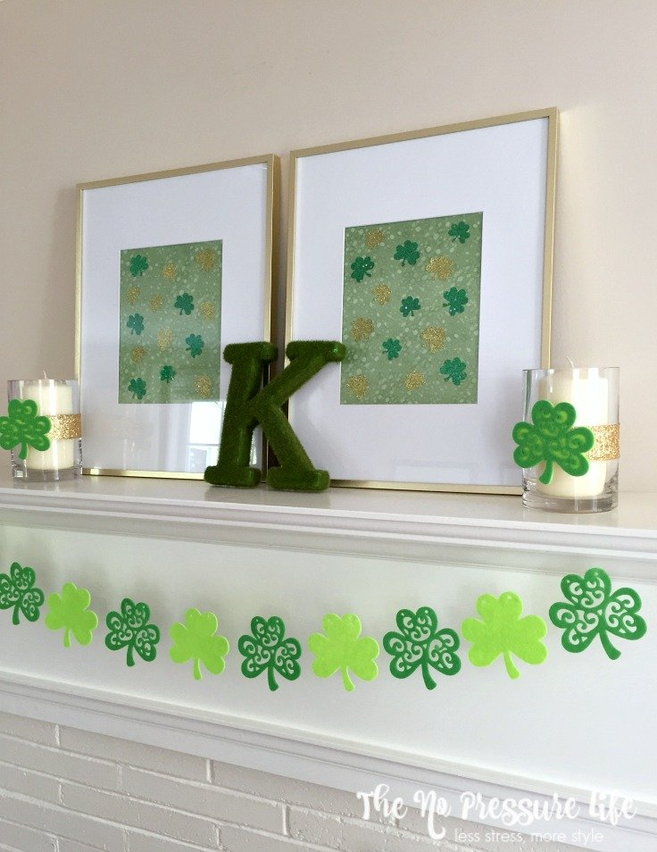 DIY St. Patrick's Day mantel decorations with shamrock banner and green DIY art