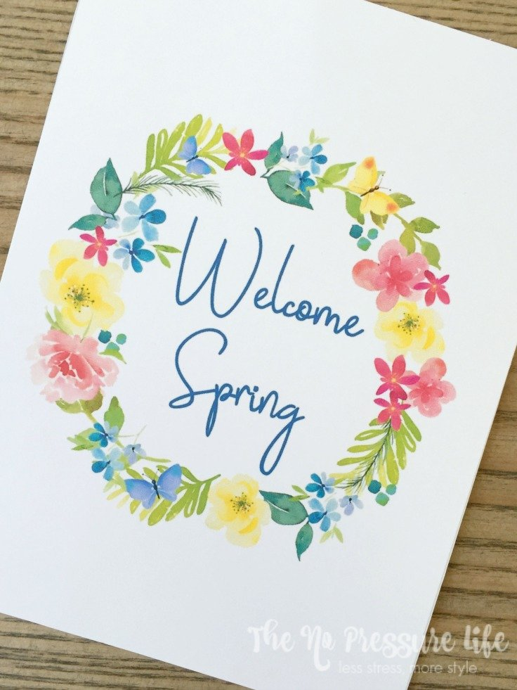 Welcome Spring free spring printable art, text surrounded by a colorful floral wreath