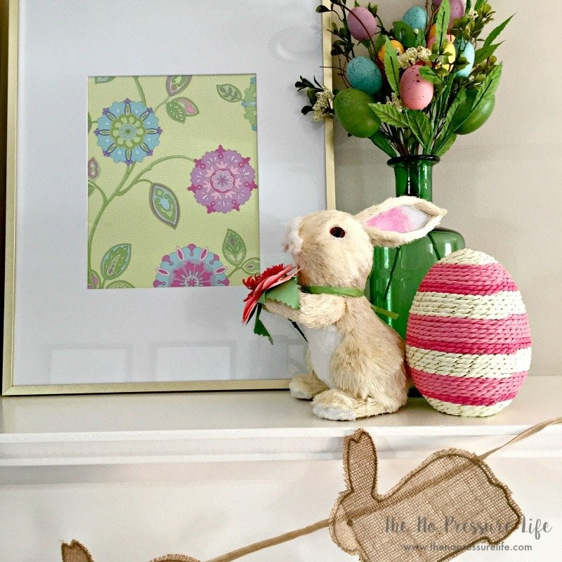 Easter Mantel Decorating Ideas - pink and green Easter mantel decorations on a fireplace