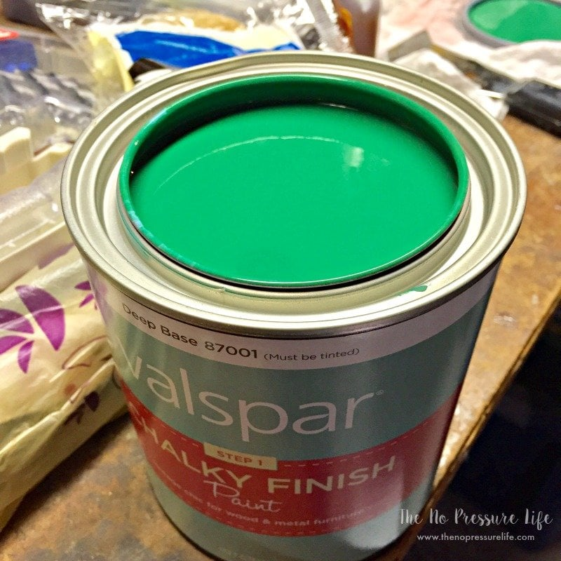 Open can of green chalk paint