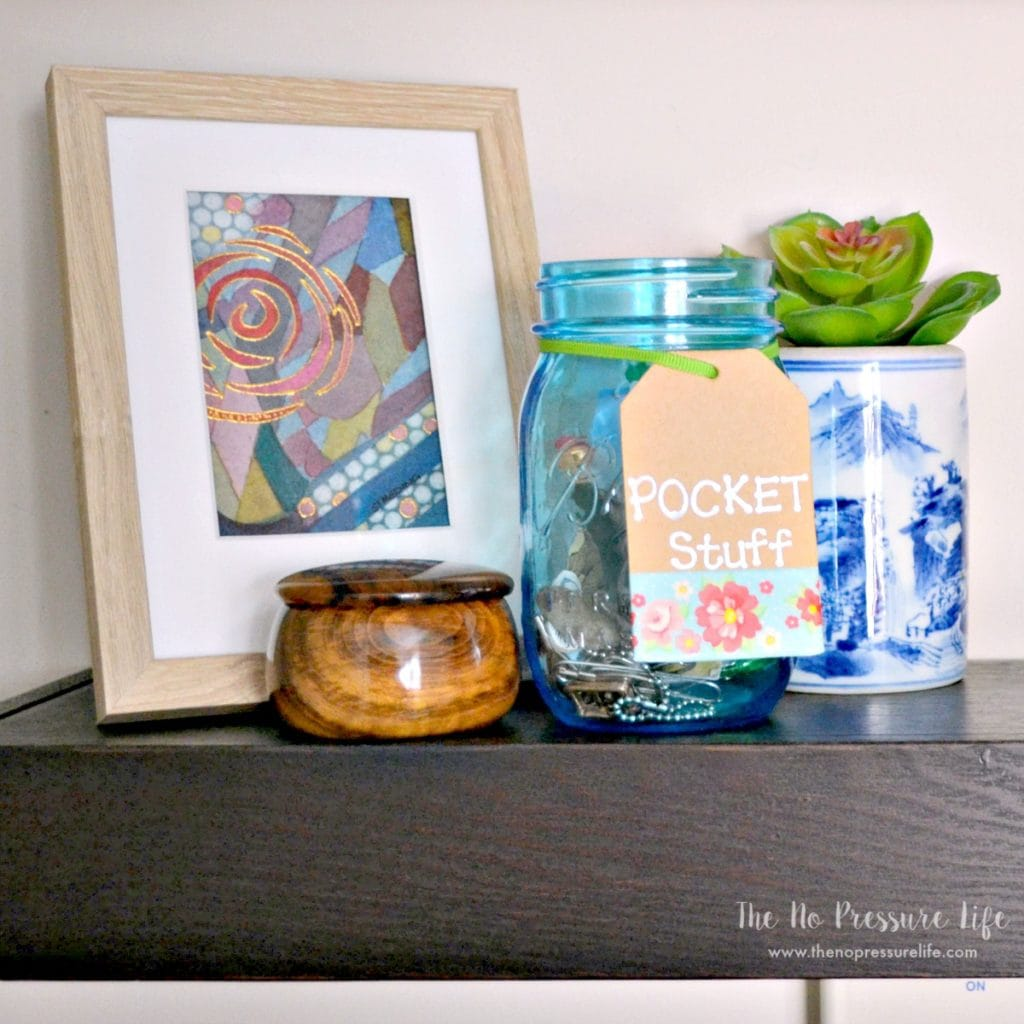 Laundry room shelf with jar to collect stuff from pockets