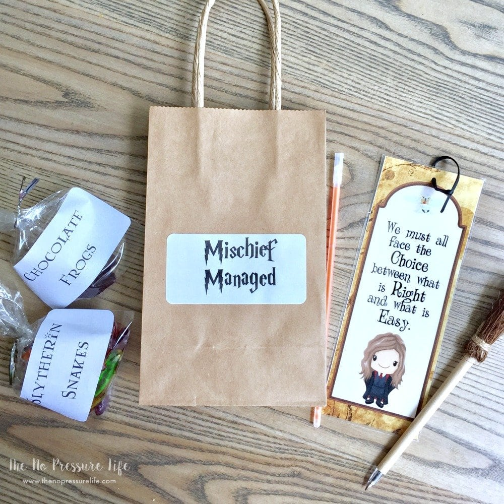 Harry Potter Party favors and DIY goodie bag with witch broom pens, DIY chocolate frogs, and printable bookmark