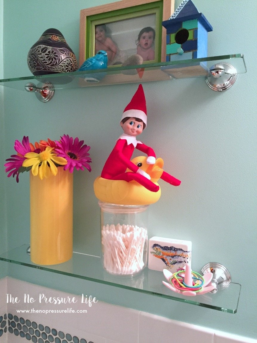 easy elf on the shelf ideas: sitting on a rubber ducky
