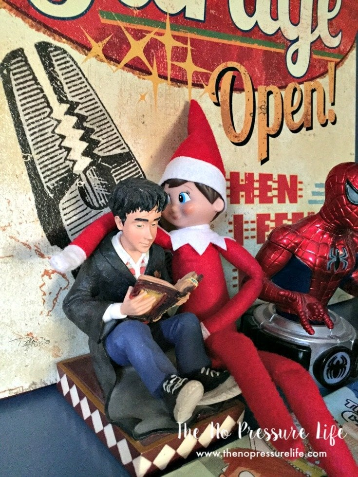 Easy Elf on the Shelf Ideas: Elf posing with a bookend