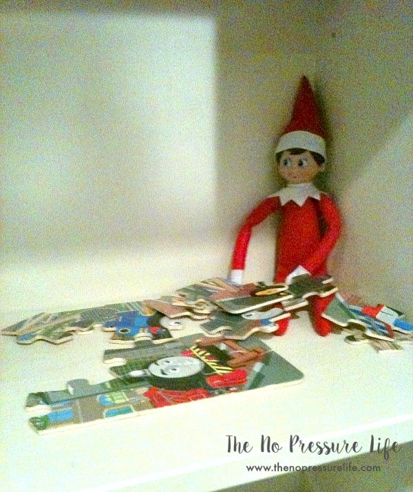 easy elf on the shelf ideas: put together a puzzle