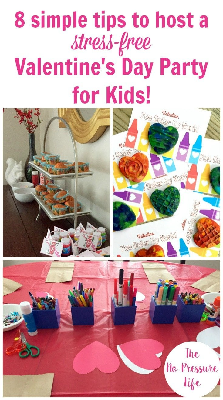 Valentine's Day party for kids with a cupcake decorating station, craft projects on a red tablecloth, and Valentine's Day cards