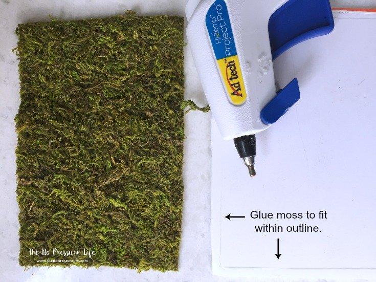 hot glue gun and sheet moss