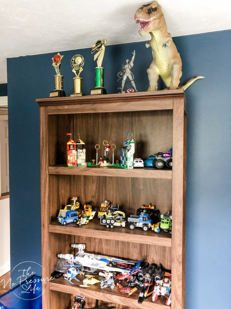 Brown bookcase for LEGOs in a boy's bedroom