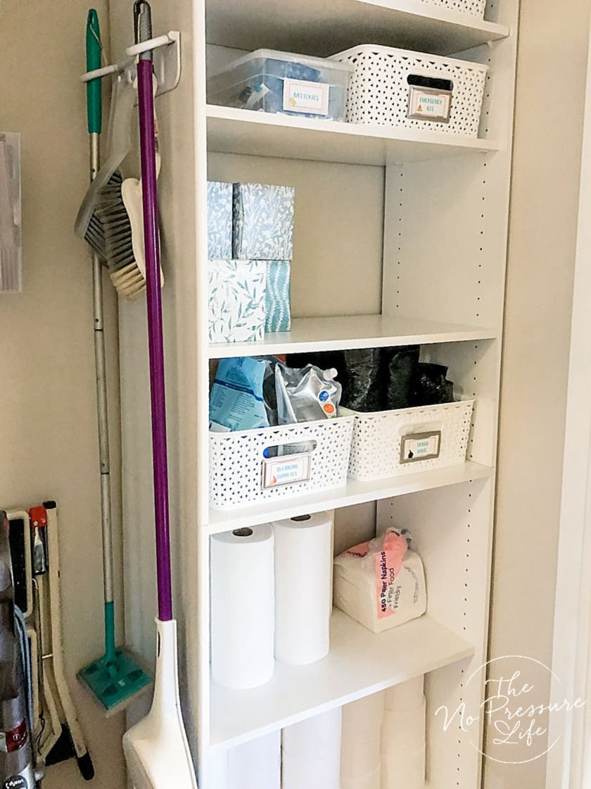 Broom and cleaning supply storage in a closet
