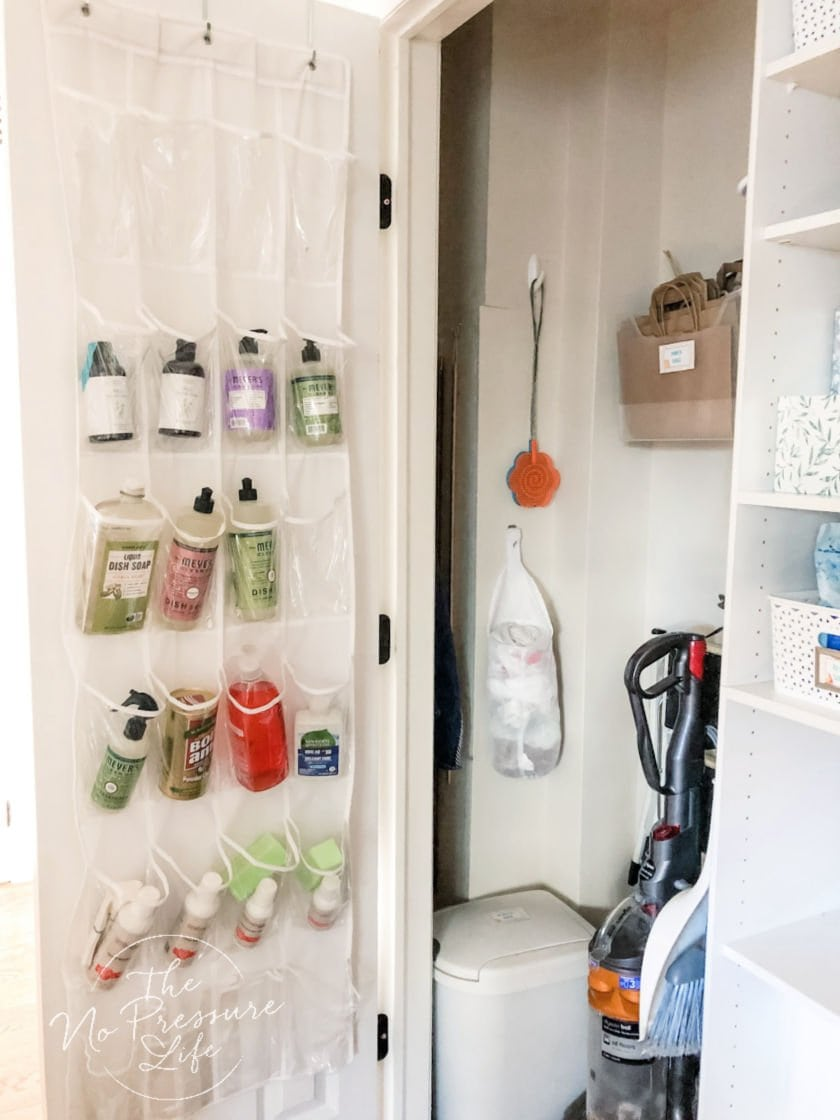 Organized broom closet with a shoe pocket organizer