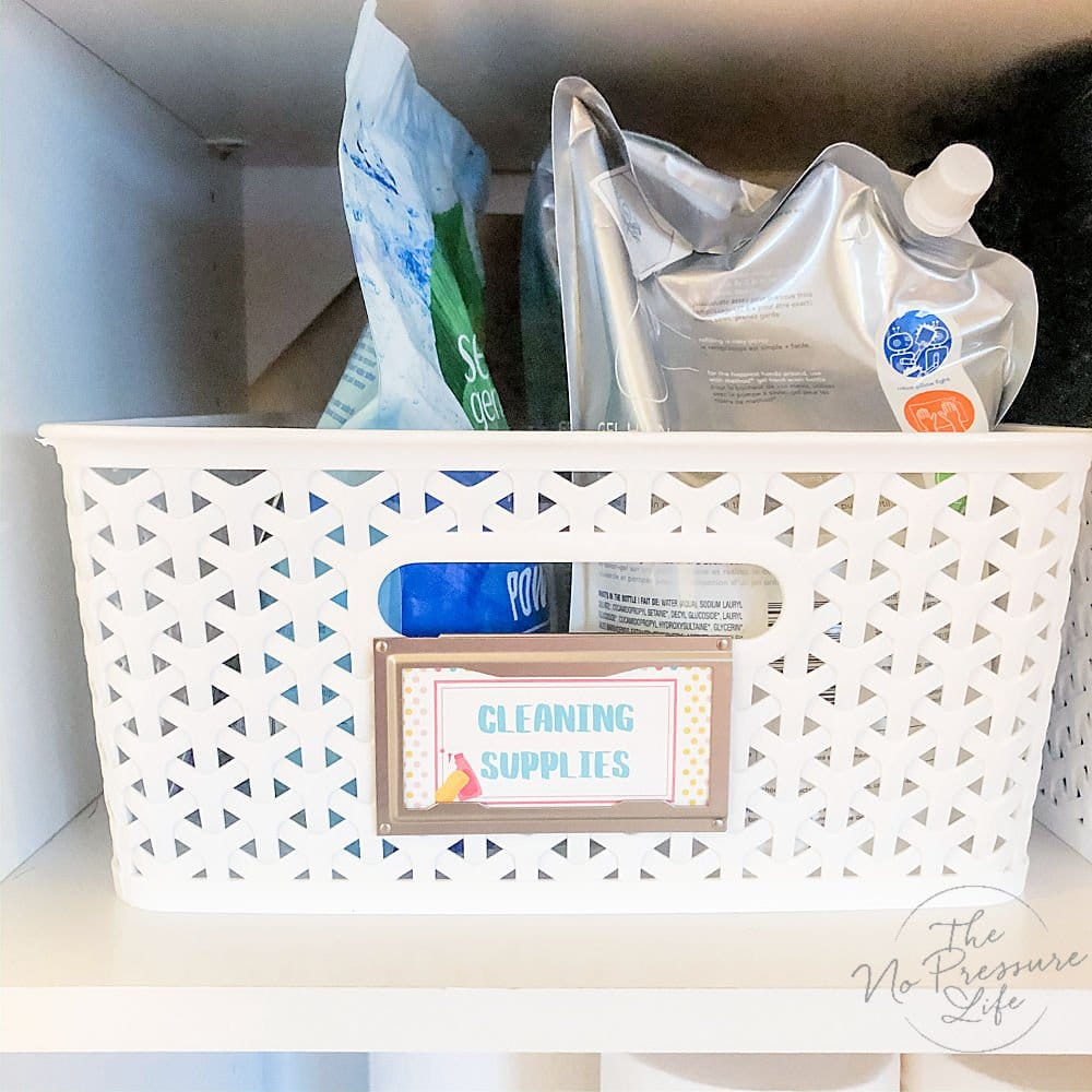 White basket for cleaning supplies in a broom closet