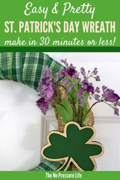 DIY St. Patrick's Day Wreath with green plain ribbon on a door