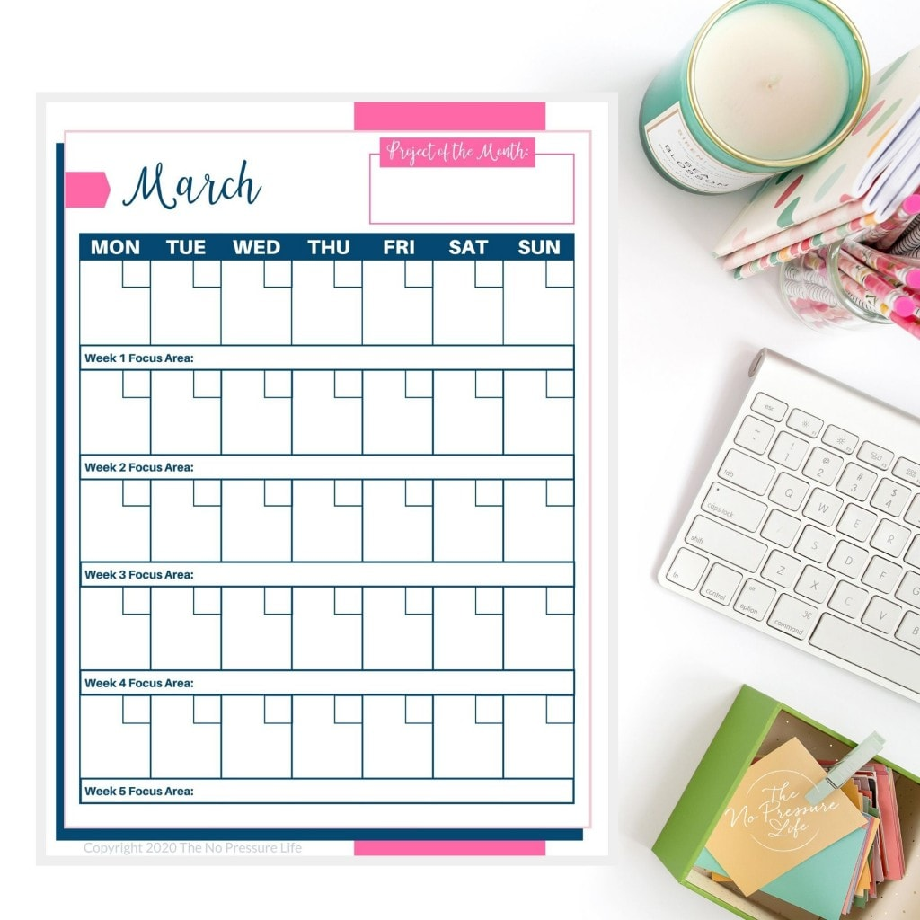 Monthly Decluttering Calendar on a white desk