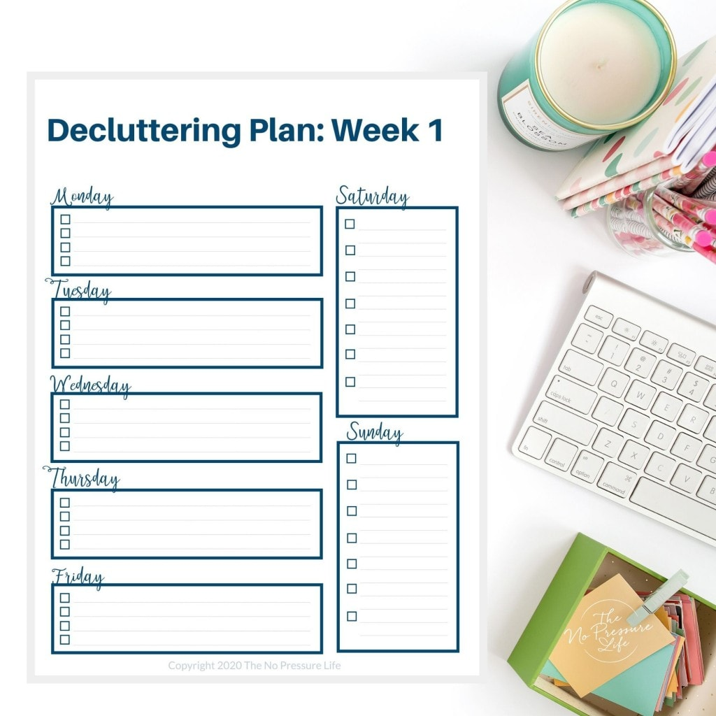 weekly decluttering plan on a white desk