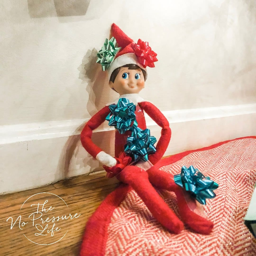 Elf on the Shelf covered in mini bows