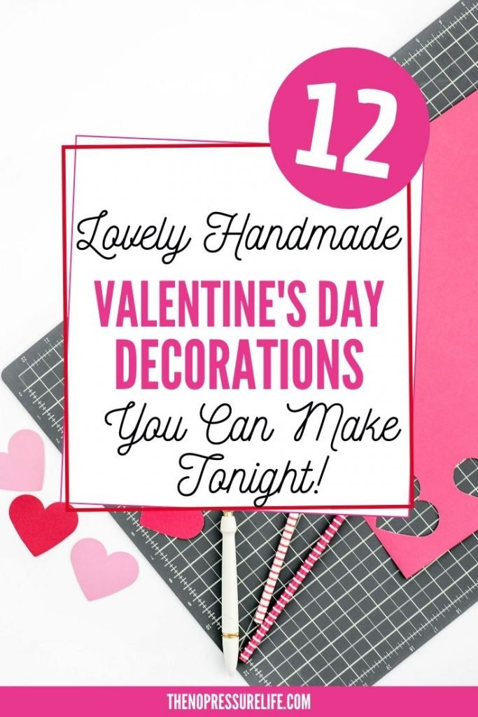 "Red and pink paper hearts and text ""12 Lovely handmade Valentine's Day decorations you can make tonight"""