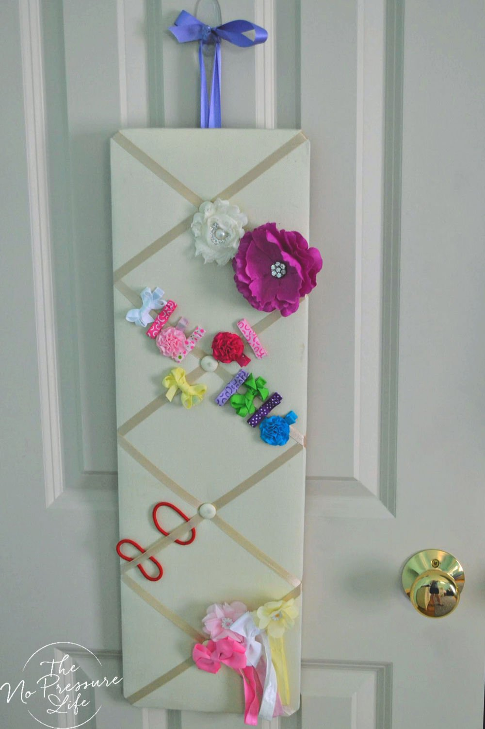 Organizing hair accessories on a door with a memo board