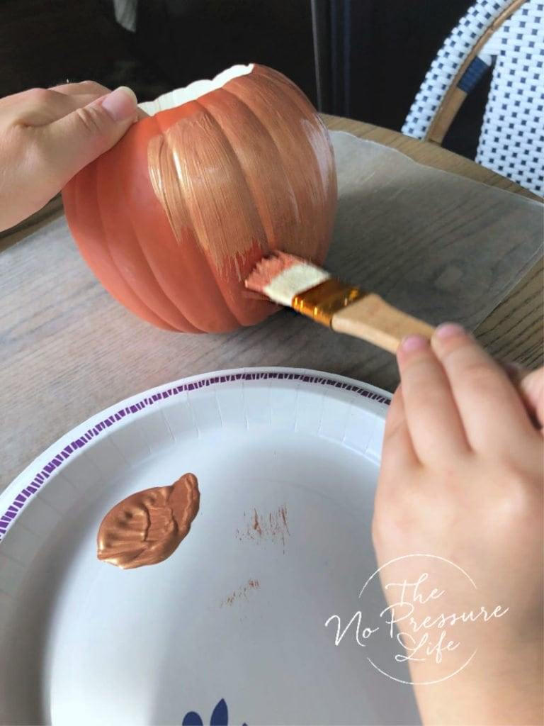 Painting a faux pumpkin with copper paint