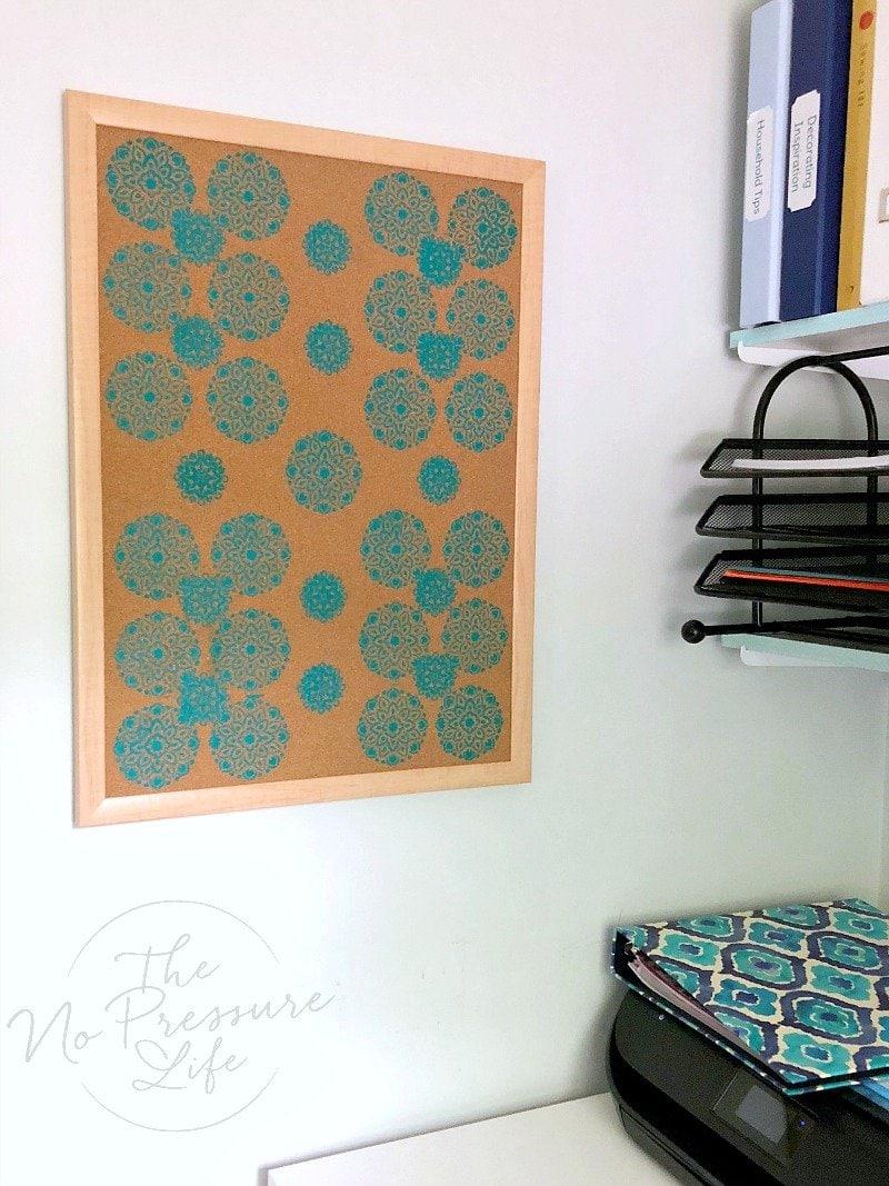 DIY stenciled cork board in craft room