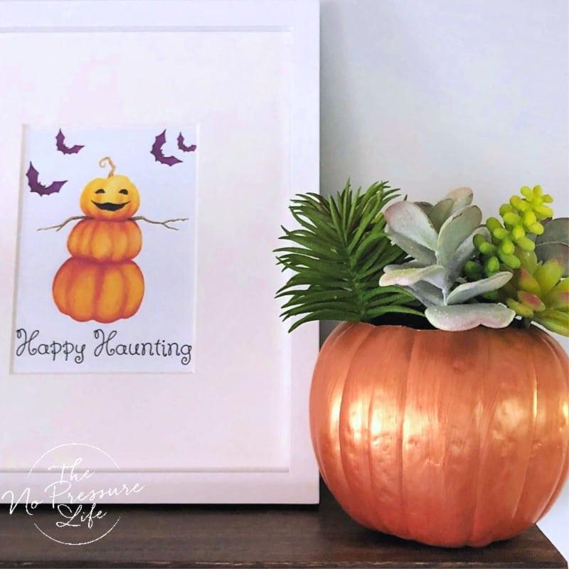 Faux succulent pumpkin planter centerpiece for Thanksgiving